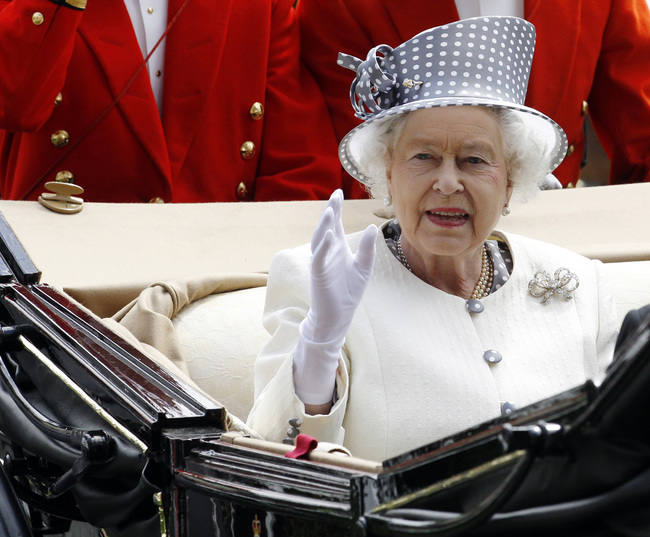 Britain's Queen Elizabeth waves as she arrives on the fifth day of racing at Royal Ascot in southern England