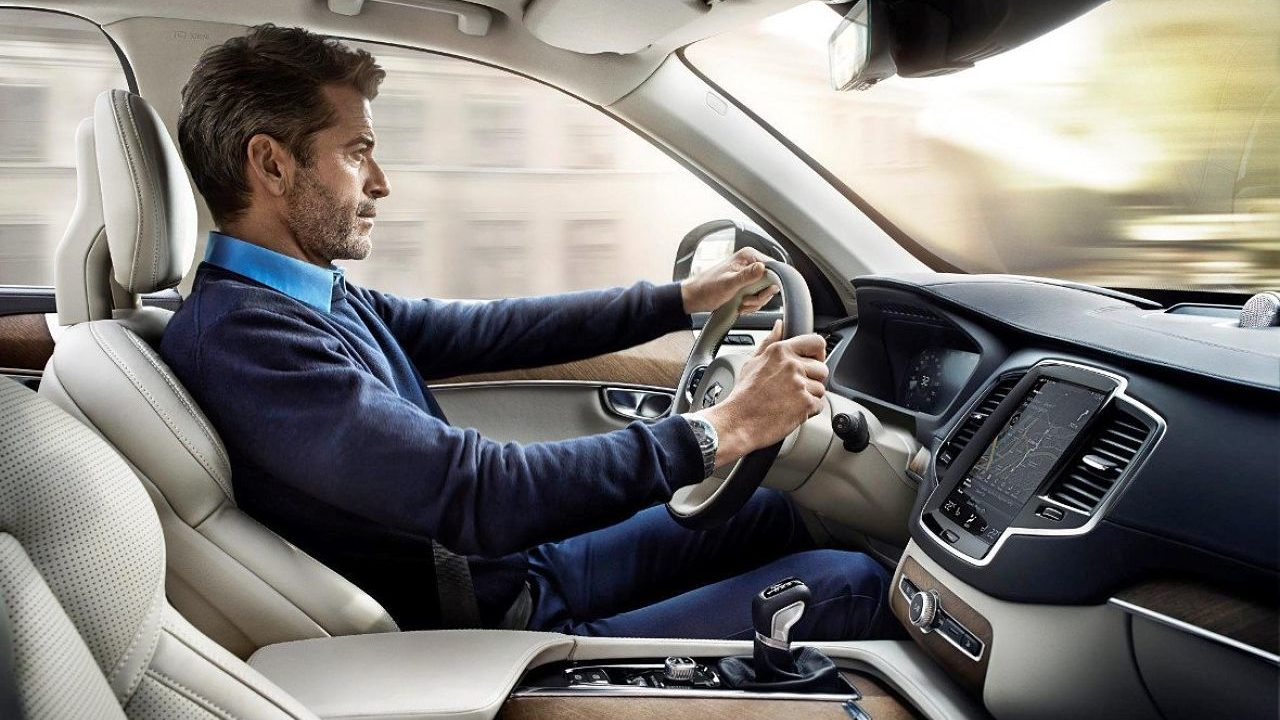 postura conducir