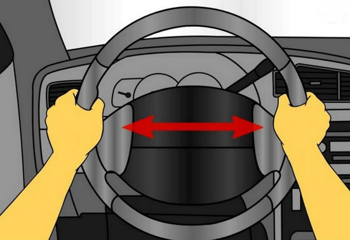 conducir con las dos manos en el volante