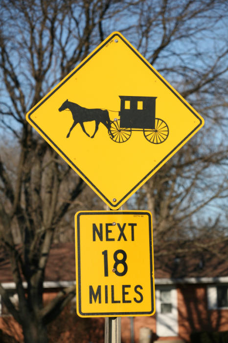 Señal tráfico peligro amish