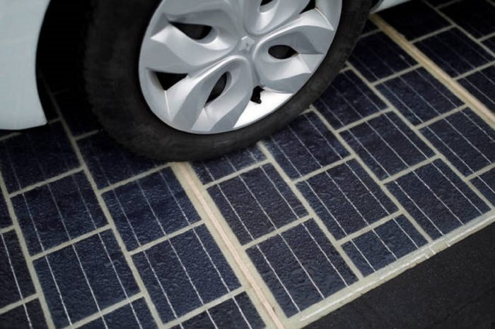 the-tyres-of-an-automobile-are-seen-on-a-solar-panel-road-during-its-inauguration-in-tourouvre-normandy-northwestern-france-december-22-2016-reuters-benoit-tessier